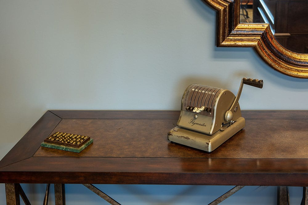Abacus and vintage Paymaster check writing machine on a table