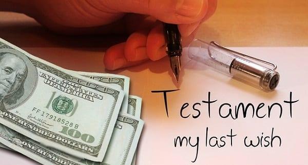 "Hundred dollar bills next to writing that says ""testament - my last wish"""